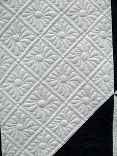 I love whole cloth quilts.  It showcases the quilting instead of the fabric.