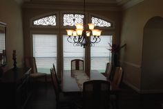Faux Iron Conroe, TX  This Grey Stone Hills home enhanced their dining area with Faux Iron. Faux iron can be ordered for almost any size and shape window. Faux Iron adds beauty and elegance to any window and room.