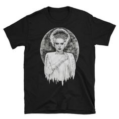 Bride+of+Frankenstein+Unisex+T-Shirt This+shirt+is+ultra+comfortable,+and+its+modern+cut+makes+it+stylish,+too.+The+rolled+shoulder+gives+it+a+better+fit,+and+the+double-stitched+hems+make+it+long-lasting+–+it+should+definitely+have+a+spot+in+your+closet!++ ++•+100%+cotton+jersey+knit++ ++•+30...