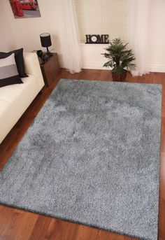 """2 tone gray long soft and durable indoor shag area rug.Tufted hand woven designed for the comfort of your home.We also have them in multiple sizes 2' x 3' ft, 5' x 7' ft ,7'6"""" x 10'3"""",4' x 5'4"""" ft, 2' x 7'5"""" http://rugaddiction.com/collections/rolex/products/2-tone-gray-long-soft-durable-shag-area-rug"""
