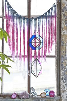 Love the crystals and geometric... thingy. What is that called, I have a brain fart. Anyway, would be pretty for my bedroom.