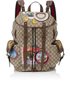 GUCCI Appliquéd Gg Supreme Flap-Front Backpack. #gucci #bags #leather #canvas #backpacks #stone #