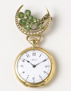 Tiffany Co. A Lady's 18k gold pendant watch on 14k gold, enamel and pearl bow - circa 1910.