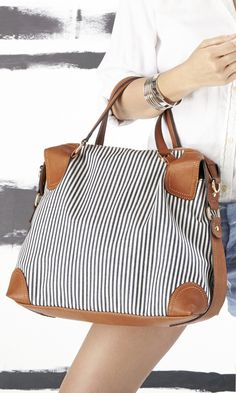 Blue striped satchel bag with top handles and a removable shoulder strap