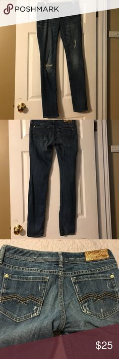 Express Zelda ripped jeans. Worn but still has a lot of life in them! Express name on inside of Jeans wearing off as pictured, as well as brown tag in back. Size 4, stretchy material! Express Jeans Straight Leg
