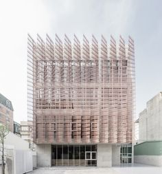 """""""Feather-like"""" screens front church in Taiwan by MAYU Architects"""