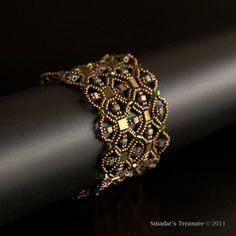 Shiney Bronze Beaded Bracelet with Sparkling Swarovski Crystals Olivin Green Beads. Geometric Net Lace Style