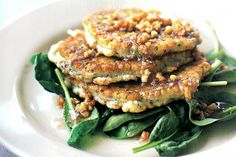 These tasty fritters are elevated to gourmet status when served with the rich walnut dressing.