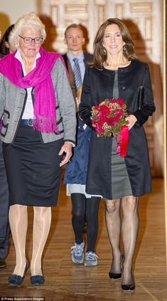 Bright bouquet: The Princess was given a red and pink bouquet of flowers which she carried on her way out of the function