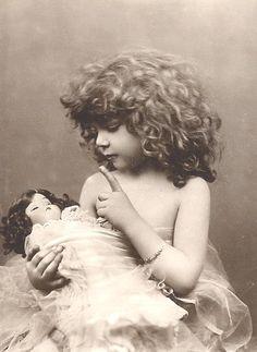 girl & sleeping doll