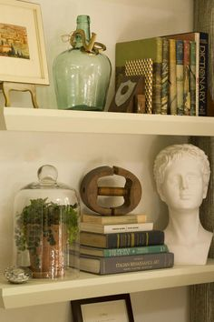 Floating Shelves - Real-Life Redo: Cozy Den - Southernliving. Originally, Anne Turner had an étagère in mind for the area located to the right of the doorway behind the club chairs. When she couldn't find one that fit her budget, she went with floating shelves instead. She then filled the custom shelf arrangement with new finds and family mementos, such as her grandfather's bookends. To balance the shelves, she added a large mirror to the left of the doorway to give the small room more…