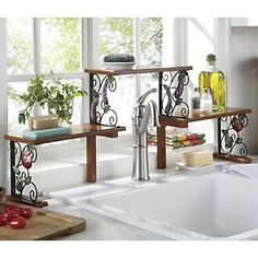 "#JA73177 - 2-tier Garden Bounty Over-the-Sink Shelf - Stepped tiers make room for soap, scrubbies, pretty accents, small potted plants and even your vegetable brush. Fits single and double sinks up to 36"" wide. Design allows space for gooseneck faucets.  Metal frame with solid and composite wood. Assembly required. 35 3/4"" w x 14"" h x 6"" d."