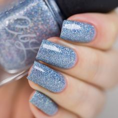 Colors by llarowe Holiday 2016 Collection - Twinkling Lights is a soft blue/grey base with ultra micro holographic glitter and cobalt blue shimmer. Dries to a light texture and matte. Top with a good quality top coat for added protection and shine and to smooth surface. This polish is easier than most glitters to remove and does not require soaking off. Swatch by @lakkomlakkom on Instagram.