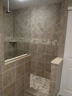 17 mosaic tiles on the walk-in shower walls - DigsDigs