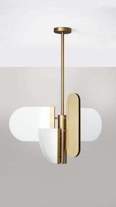 A play on geometry. Random geometric shapes were rotated horizontally and vertically, then joined together at the central pole to form a pendant. Thin glass sheets were inserted into metal channels with a light strip in between. For contrast, rounded meta Lighting Uk, Strip Lighting, Interior Lighting, Modern Lighting, Lighting Design, Brass Pendant Light, Modern Pendant Light, Pendant Lamp, Pendant Lighting