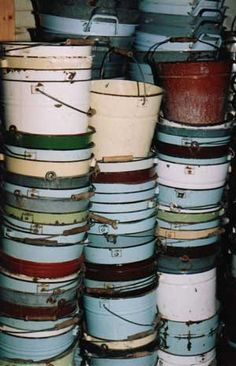 Vintage enamel buckets.  I think I would pass out if I came across this pile of buckets at a market!