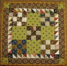"""Made this mini quilt for my daughter but I think it's time to make another one for myself. It's about 7"""" square. I love doing the little 9 patches... the half square triangles are a little trickier but if you use Thangles or foundation paper piecing, it's not too bad."""