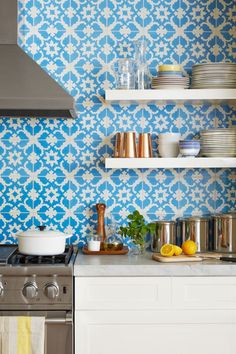 The vibrant, quilt-like backsplash creates a focal point. Made from cement, it also lends subtle texture. (Snowflake in Leon, $5/tile; cubantropicaltile.com)