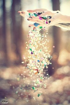 Guests throw a fist full of glitter in the air? after we say I do and we walk down the aisle to get into the limo for the reception<3