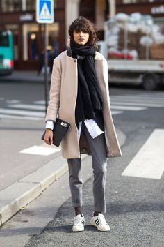 Camel coat, neat trousers, Adidas Superstar trainers, white blouse, clutch