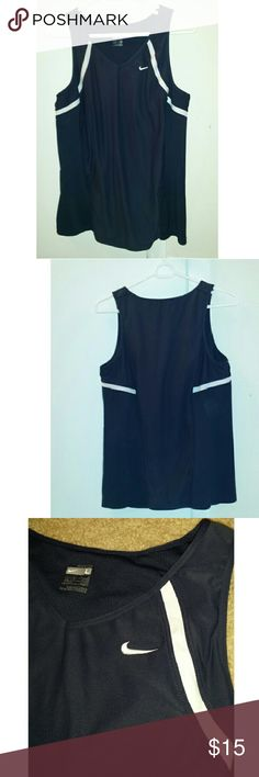 PRICE DROP Nike Fit Dry Navy Tank Size L 12-14 *** Good pre-owned condition! ***  Nike Fit Dry Size: Large (12-14) Colors: Navy Blue/White Athletic Tank Body: 88% Polyester 12% Spandex Mesh: 86% Polyester 14% Spandex  Straps: 100 % Polyester  bra mesh: 81% nylon 19% Spandex  bra lining: 92% Polyester 8% Spandex Nike Tops Tank Tops