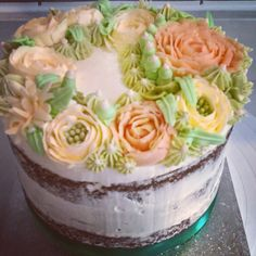 The way to make a carrot cake beautiful! A semi-naked carrot cake topped with hand piped Swiss meringue buttercream flowers. A beautiful birthday cake from Philly's Kitchen.