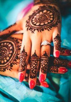 Bridal mehndi or henna design. Bridal diamond engagement ring. manicure