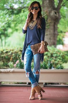 Distressed jeans, statement necklace