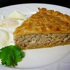 Meat Pie (Tourtiere) Recipe Main Dishes with ground pork, baking potatoes, onion, salt, ground black pepper, ground cinnamon, ground cloves, ground allspice, water, pastry, double crust, eggs, paprika