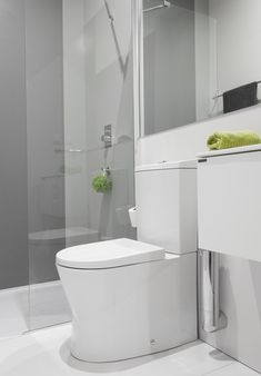 Narrow bathroom with Sanindusa products. Small toilet size. Small basin with cabinet