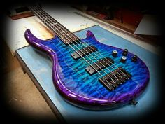 Carvin 5-string bass  very cool color not sure if i would do it.  i wonder if it is one of the ICON basses