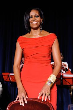 Mrs. Obama stuns in a crimson Prabal Gurung gown at the White House Correspondents' Association dinner in Washington, DC.   - ELLE.com