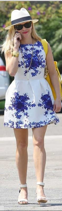 Who made Reese Witherspoon's black handbag, white dress with blue flowers, and…