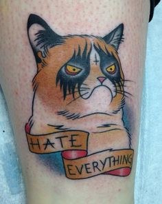 """Grumpy Cat Tattoo """"Hate Everything""""  Tom Taylor of Philadelphia-based tattoo shop, Deep Six Laboratory, has inked a rather awesome Grumpy Cat tattoo based on the likeness of Tard the Grumpy Cat."""