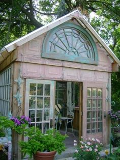 greenhouse made from old windows, love the tin siding (old tin ceiling tiles) by christie