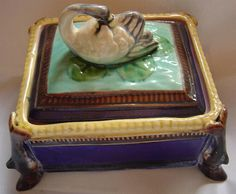 ANTIQUE ENGLISH MAJOLICA SARDINE    BOX / SERVER WITH SWAN FINIAL LID_    UNMARKED_    Condition : Restored lines to lid & chips to base_  SIZE IS --17cm x 13cm  _  SHIPPING INCLUDED