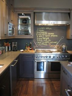 Chalk board paint would be and inexpensive and cool backsplash idea for our basement wet bar until we upgrade it... could write party wishes and specialty cocktail menus.  With stainless steel open shelves on either side??