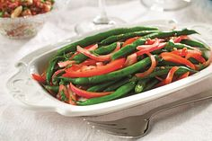 Peruvian Green Beans With Canola Oil, Green Beans, Red Onion, Garlic, Low Sodium Soy Sauce, Balsamic Vinegar, Amarillo, Ground Cumin, Tomatoes, Chopped Cilantro