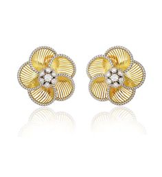 A pair of gold flower petal earrings of knife-wire design with a corded edge and a diamond cluster center, in 18k and platinum. Atw. 2.60 ct...
