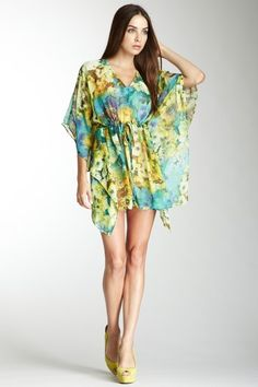 The kimono sleeves, defined waist, floral print is perfect for summer.