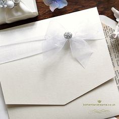 With layers of delicate ribbons in the colour of your choice, finished with a sparkly crystal to add that extra touch, this is a simple wedding invitation ideal for modern themes where a more minimalist look is wanted. Price starts from Luxury Wedding Invitations, Wedding Wishes, Wedding Themes, Wedding Stationery, Our Wedding, Crystal Wedding, Ribbons, Layers, Delicate