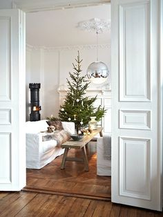 A Christmas Home. Tree in front of fireplace slightly to the side