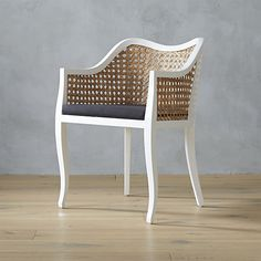 OBSESSED.. Best new chair I have seen in a while...tayabas cane side chair with black cushion | CB2