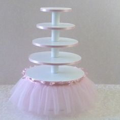 This pretty cake stand would be easy to DIY. I like that's it's not made of foam board and soap cans, which seems unstable.
