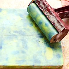 Heather Greenwood Designs - 4 easy steps mixed media tutorial using a Gelli Arts plate and masks for creating fun backgrounds  STEP TWO: using your brayer, spread and blend the paint dabs together.