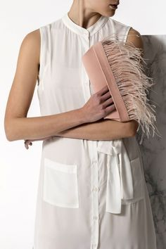 Bring a glamorous edge to your evening or wedding look with the Domna design clutch. This unique and ultra classy formal handbag is handmade of fine quality leather and silky feathers. It comes in 3 colors, nude/pink (nubuck), black and camel/brown (waxed tan). Greek Chic Handmades clutch bags are designed and handcrafted in Athens, Greece. Shop your favorite leather bag to accompany your sandals. We use the same premium leather we built the sandals with and the impeccable local craftsmanship. White Clutch, Pink Clutch, Beach Wedding Sandals, Clutches For Women, Wedding Clutch, Leather Clutch Bags, Bohemian Style, Feathers, Nude