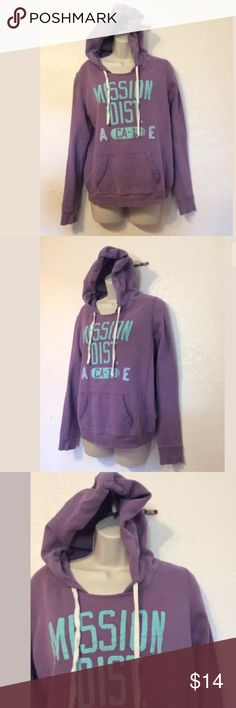 "American Eagle outfitters women's hoodie medium American Eagle outfitters women's hoodie ""mission dist"" medium. Lavender color teal print, Drawstring, front hoodie pouch pocket, long sleeves, 85% cotton 15% polyester new without Tags flawless American Eagle Outfitters Tops Sweatshirts & Hoodies"