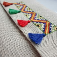 Adding tassels to Embroidery Embroidery Bags, Simple Embroidery, Folk Embroidery, Hand Embroidery Stitches, Cross Stitch Embroidery, Embroidery Patterns, Cross Stitch Borders, Cross Stitch Flowers, Modern Cross Stitch