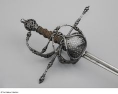 Rapier Federico Picinino Milan, Italy c. 1625 - c. 1635 Iron or steel and copper Length: 133.35 cm Length: 115.7 cm, blade Width: 2.2 cm Weight: 1.34 kg Maker's mark: Castle of Milan with 'FEDRICO' and 'PICININO' around it A646 European Armoury III