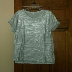 Gap silver tee New eithout tags, silver, shiny crewneck tee. Short sleeves that are cuffed. Super cute to wear under a blazer! GAP Tops Tees - Short Sleeve